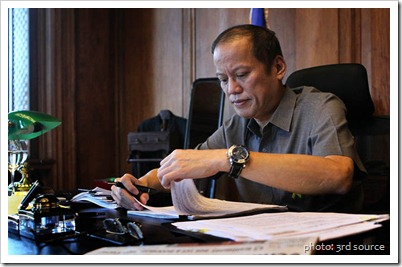 President Benigno S. Aquino III goes over his papers in his office in Malacanang Palace as he admitted feeling better today, Thursday, March 15, 2012. Yesterday the President was not able to meet some of his visitors as he was not feeling well. (Photo by Gil Nartea?Malacanang Photo Bureau)